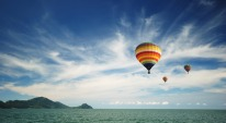 Beautiful hot air balloon over cloudy blue sky
